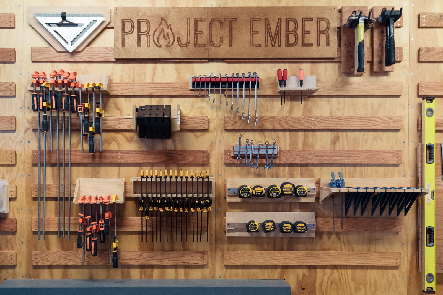 The organized tool shed wall at Project Ember.
